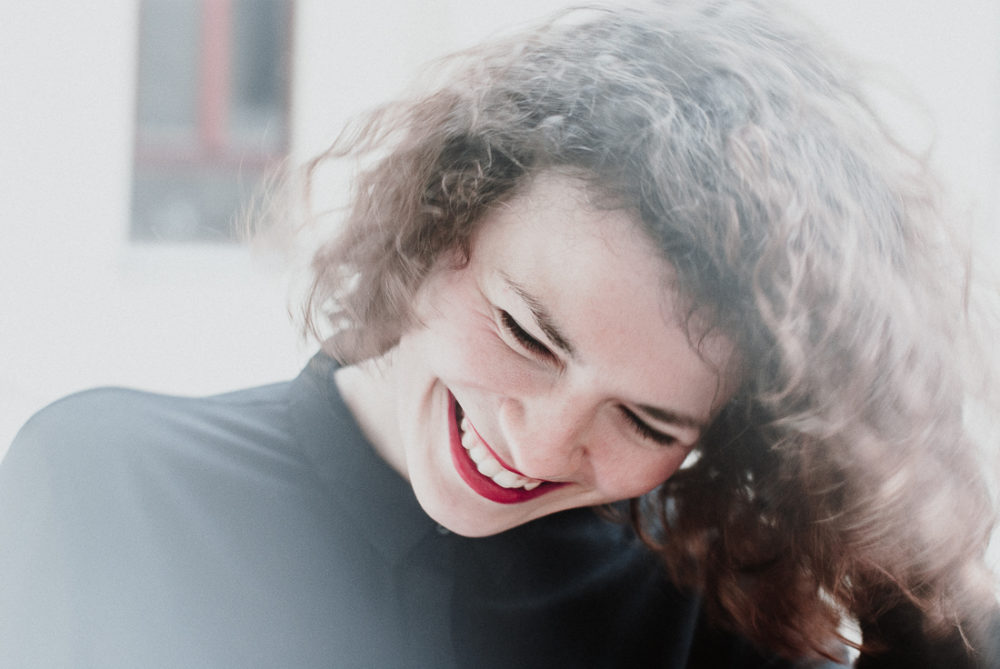 Smiling woman with red lips in Madrid
