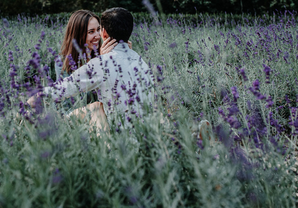 Couple sitting in lavender field