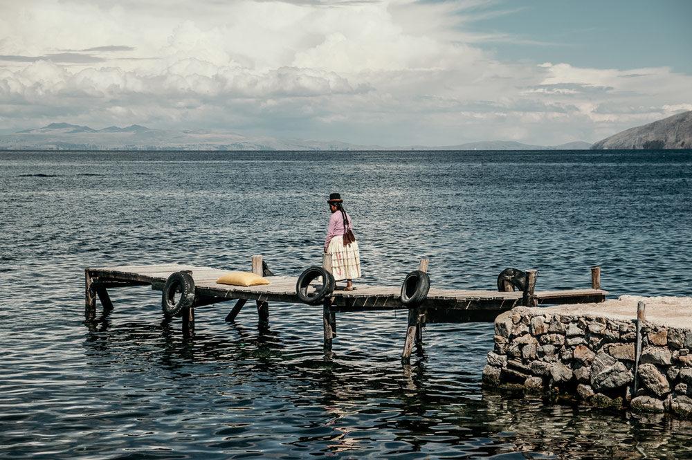 Woman on a bridge in Bolivia
